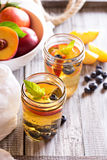 Green iced tea with nectarines and blueberries Stock Photos