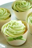 Green Icing Cupcakes. Delicious-looking dessert with green icing - for wedding receptions, family reunions, or for special occassions such as Saint Patrick's Day royalty free stock image