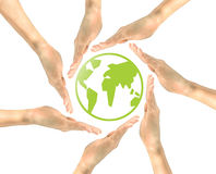 Green icon planet earth in the hands of the people Stock Photo