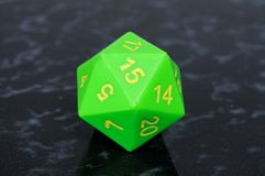 Green icosahedron 20 sided dice. Green icosahedron 20 sided shaped numbered die Stock Photo