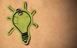 Green ideas. Green lightbulb concept, paper bulb fixed on a kraft paper background with copy space Royalty Free Stock Image