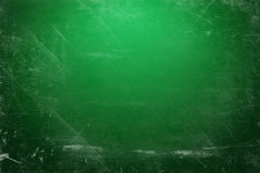 Green illuminated chalk board. Illustration of a green chalk board with scratches Stock Photo