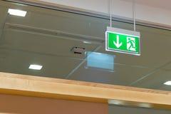 Green illuminated exit sign Royalty Free Stock Photos