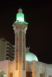 Green illuminated mosque in Abu Dhabi Stock Photos