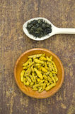 Green indian tea and dry turmeric root in wooden plate Royalty Free Stock Photography
