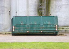 Green Industrial Container with Concrete Wall Background Royalty Free Stock Images