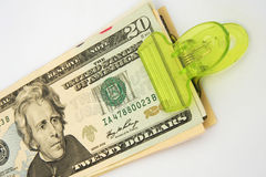 Green investment or green returns. A macro image of Dollar bills held together with a green magnetic clip symbolic of green investment funds or green returns Stock Photos