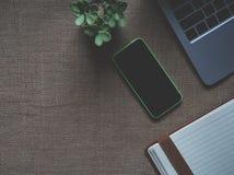Green Iphone 5c Near Macbook Royalty Free Stock Photo
