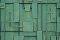 Green iron fence with a pattern of geometric lines of metal. Full Frame Background of Metal Door Frame Pattern royalty free stock images