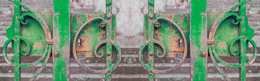 Green iron gate closed Stock Images