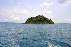 Green island among blue sea Royalty Free Stock Photo