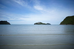 Green island and sea with a wave and clear blue sky, prachuapkhirikhan Thailand.  royalty free stock photo