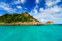 Green Island in Turquoise Water Stock Photo