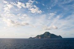Green Island Under Dramatic Sky Royalty Free Stock Image