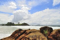 Green Island Under White Clouds and Blue Sky at Daytime Royalty Free Stock Photography