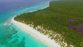 Green island with white sand beaches and crystal clear water of the ocean view from the drone. In slow-motion stock video