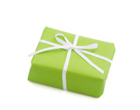 Green isolated giftbox tied with white ribbon. For christmas, birthday or valentine's day royalty free stock photos