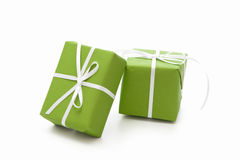 Green isolated giftboxes tied with white ribbon for christmas Royalty Free Stock Photos