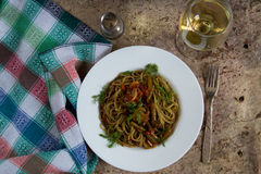 Green italian spaghetti with mushrooms and green beans in tomato Stock Photo