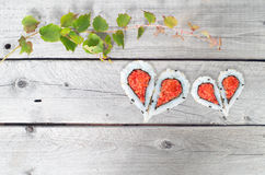 Green ivy vine and two hearts Royalty Free Stock Photos
