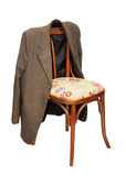 Green jacket hangs on a chair Stock Photo