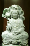 Green jade goddess. Jade goddess guanyin in dark background Royalty Free Stock Image