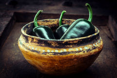 Green Jalapeno Peppers in Small Rustic Bowl Stock Photo