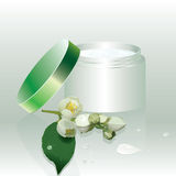 Green jar with cream and beautiful flowers Royalty Free Stock Photography