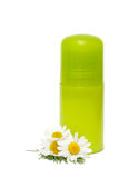 Green jar of a deodorant and camomile flower Stock Photography