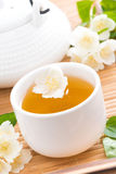 Green jasmine tea in white cups, vertical, close-up Stock Photo