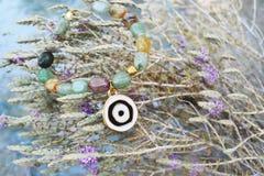 Green Jasper gemstone bracelet with pendant evil eye stock image