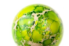 Green jasper sphere. Green jasper (also called earth jasper) sphere close-up Royalty Free Stock Photo