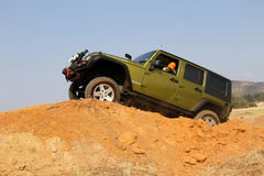 Green Jeep Wrangler Unlimited on 4x4 Course stock photo