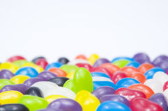 Green jelly bean standing out Royalty Free Stock Image
