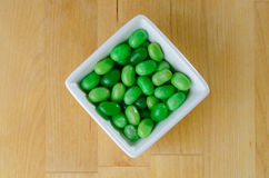 Green Jelly Beans in White Bowl Stock Image