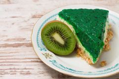 Green jelly cake and kiwi fruit on one plate Stock Photo