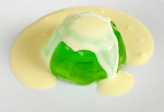 Green Jelly with Custard Stock Images
