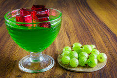 Green jelly with fruit. Stock Photo
