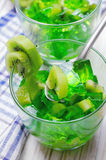 Green Jelly with kiwi fruit slices in a glass.  Stock Photography