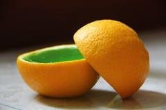 Green jelly in orange Stock Photo