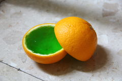Green jelly in orange Royalty Free Stock Images