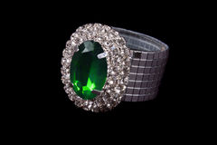 Green Jewel Ring. A beautiful ring studded with diamonds and a green jewel Royalty Free Stock Images