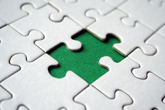 Green jigsaw element Royalty Free Stock Image