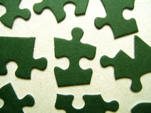 Green jigsaw pieces. Green jigsaw puzzle pieces on a white background (conceptual stock photography
