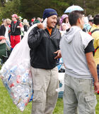 Green Jobs. Homeless person having fun with all the other people at the Bay to Breakers race in San Francisco. He carries a bag full of aluminium cans collected Royalty Free Stock Images