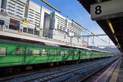 Green JR train at Kyoto  station. Royalty Free Stock Image