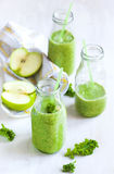 Green juice in bottle. Healthy drink. Royalty Free Stock Photo