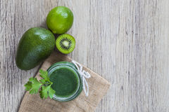 Green juice and ingredients Royalty Free Stock Photo