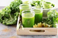 Green juice in mason jars. Healthy green kale and fruit juice in mason jars Stock Photo