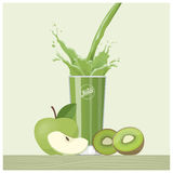 Green juice pouring into a glass Royalty Free Stock Photo